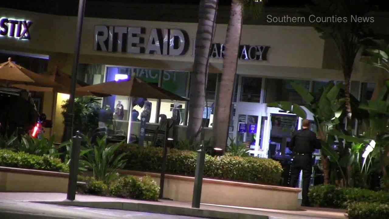 Officers respond to a call of a burglary at a Rite Aid pharmacy in Orange County on Sunday, March 13, 2016.