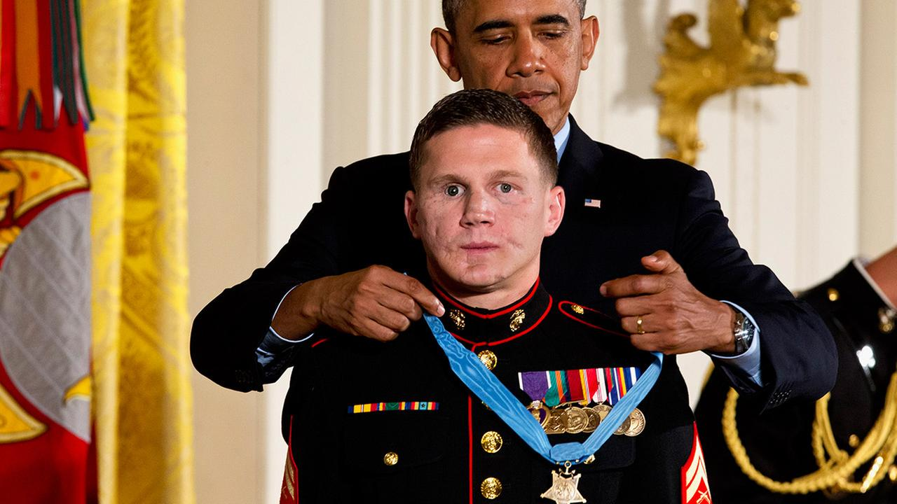 President Barack Obama awards retired Marine Cpl. William Kyle Carpenter the Medal of Honor for conspicuous gallantry on Thursday, June 19, 2014.