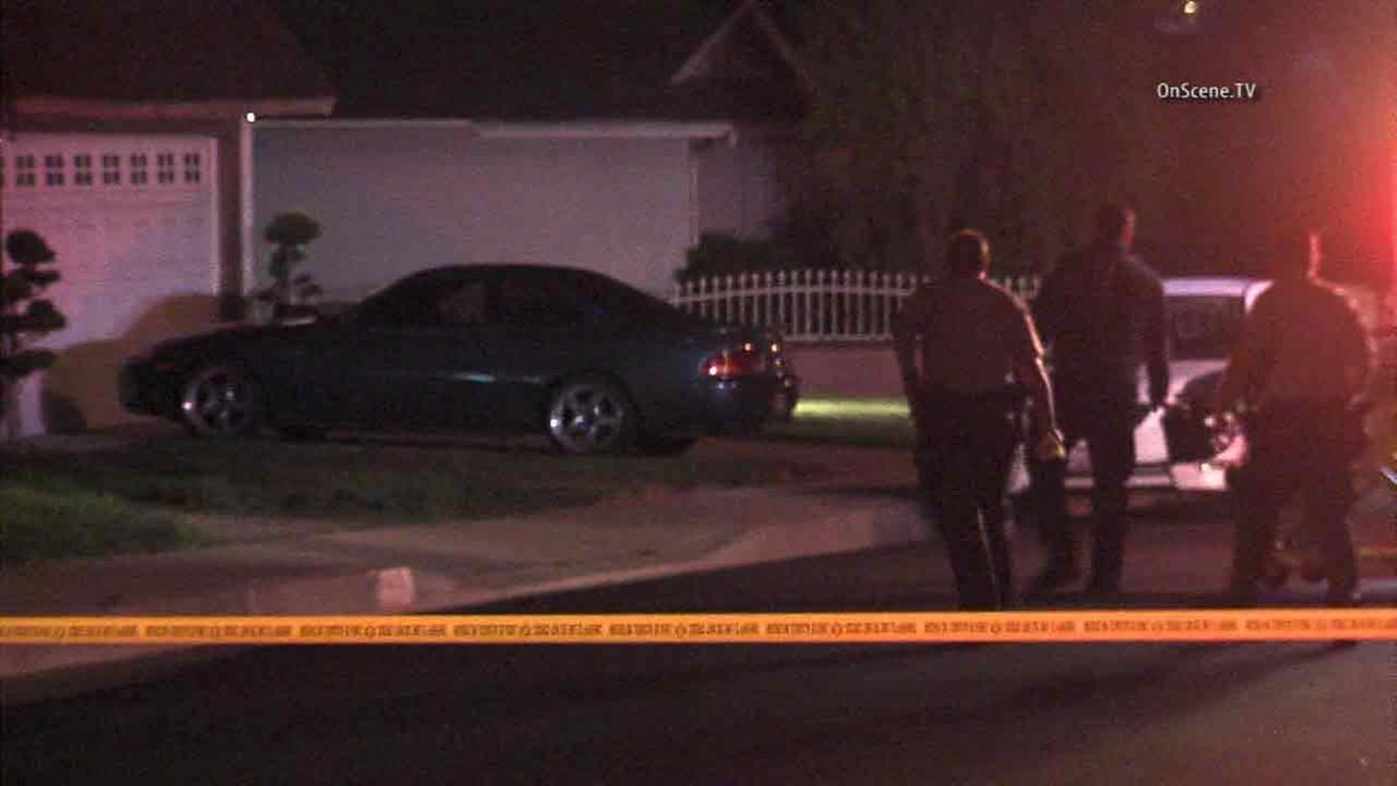 Authorities respond to a home-invasion burglary call in Rowland Heights, Calif. on Friday, March 18, 2016.