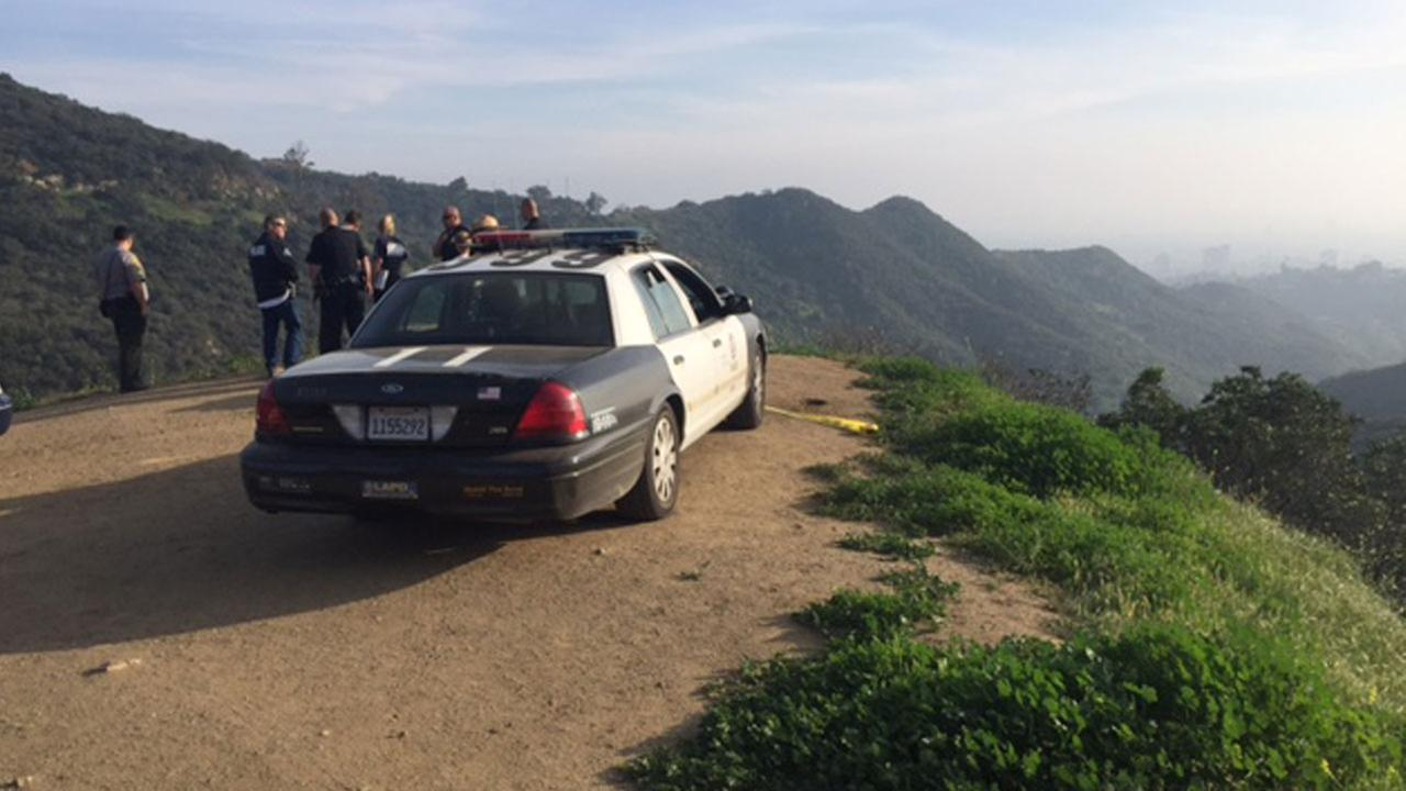 Authorities investigate the scene where hikers found a human skull near a popular Griffith Park hiking trail on Saturday, March 19, 2016.