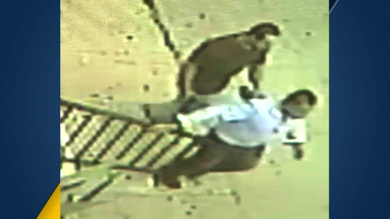 Surveillance video shows a suspect holding a gun against a mans back in a possible kidnapping in East Los Angeles on Saturday, March 19, 2016.