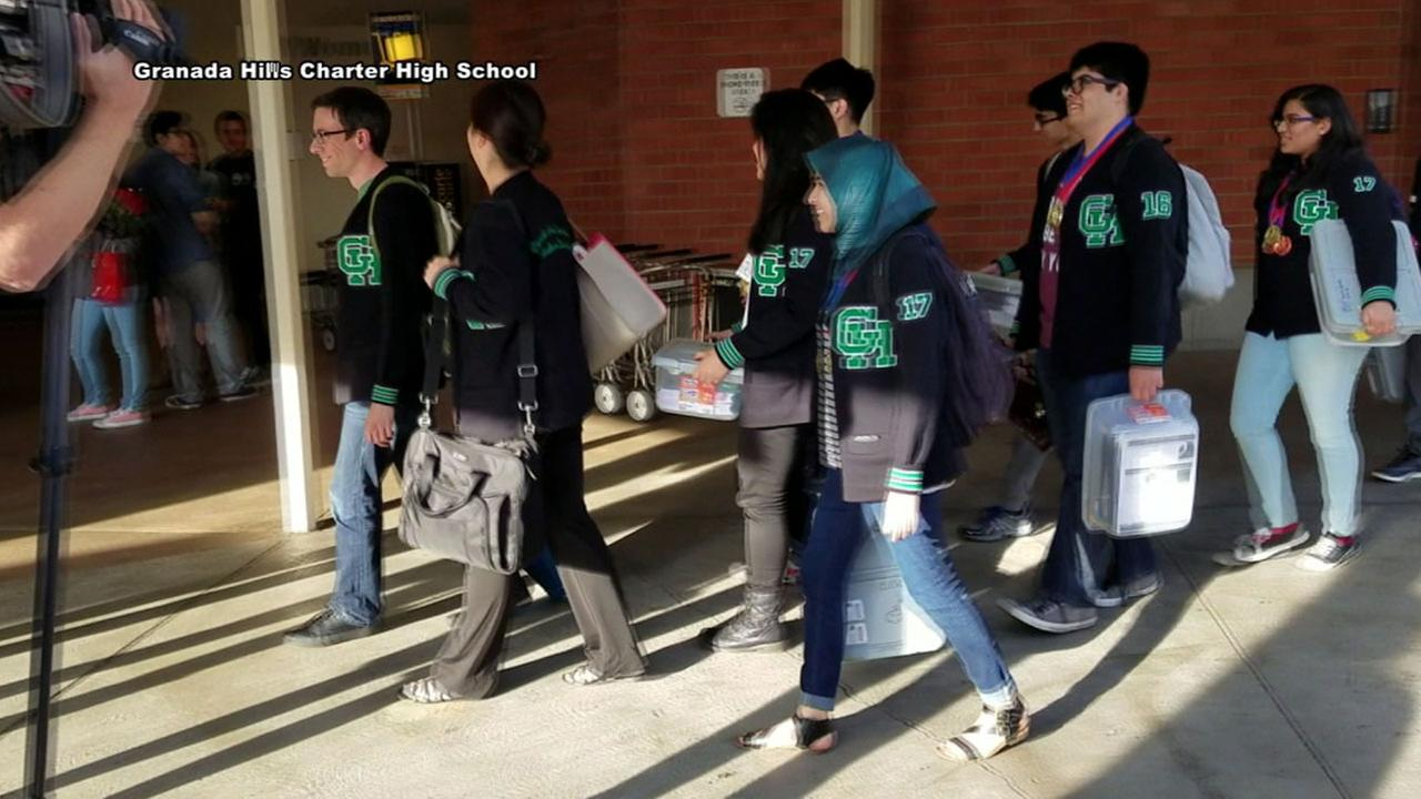 The Academic Decathlon team from Granada Hills Charter High School arrives at Bob Hope Airport in Burbank Sunday, March 20, 2016 after dominating the three-day state competition.