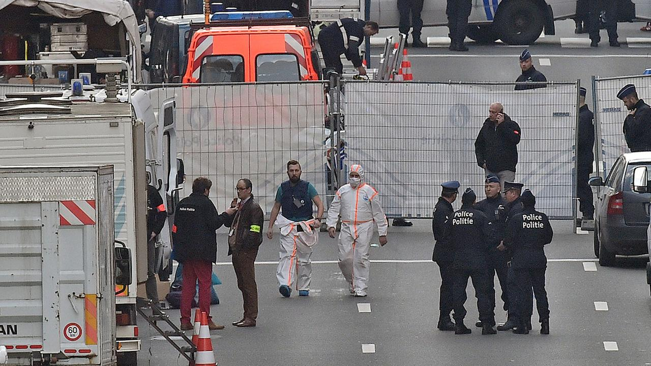 Forensic staff leave metro station Maelbeek in Brussels, Tuesday, March 22, 2016.