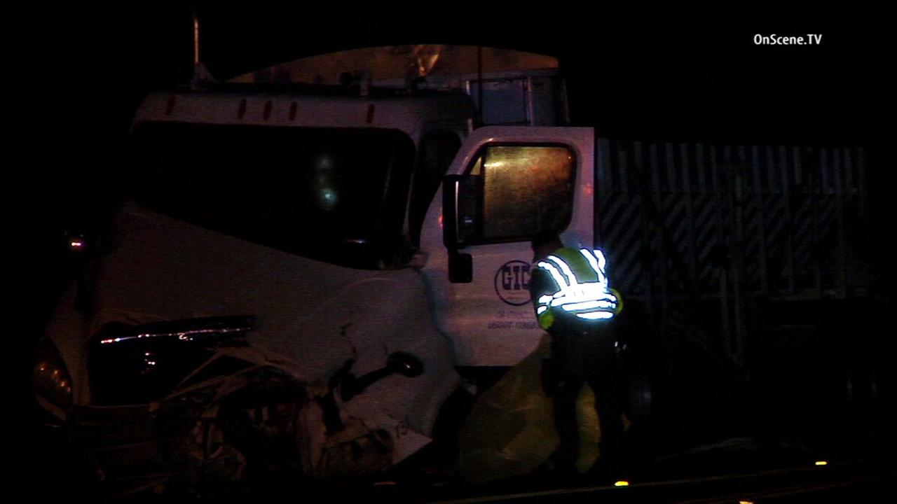 Sheriffs deputies respond to a fatal crash involving a big rig and a sedan on Ortega Highway near Antonio Parkway in San Juan Capistrano Friday, March 25, 2016.