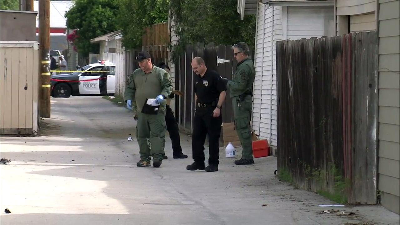 Detectives with the Anaheim Police Department and Orange County Sheriffs Department investigate a pipe bomb explosion on North Anaheim Boulevard on Sunday, March 27, 2016.