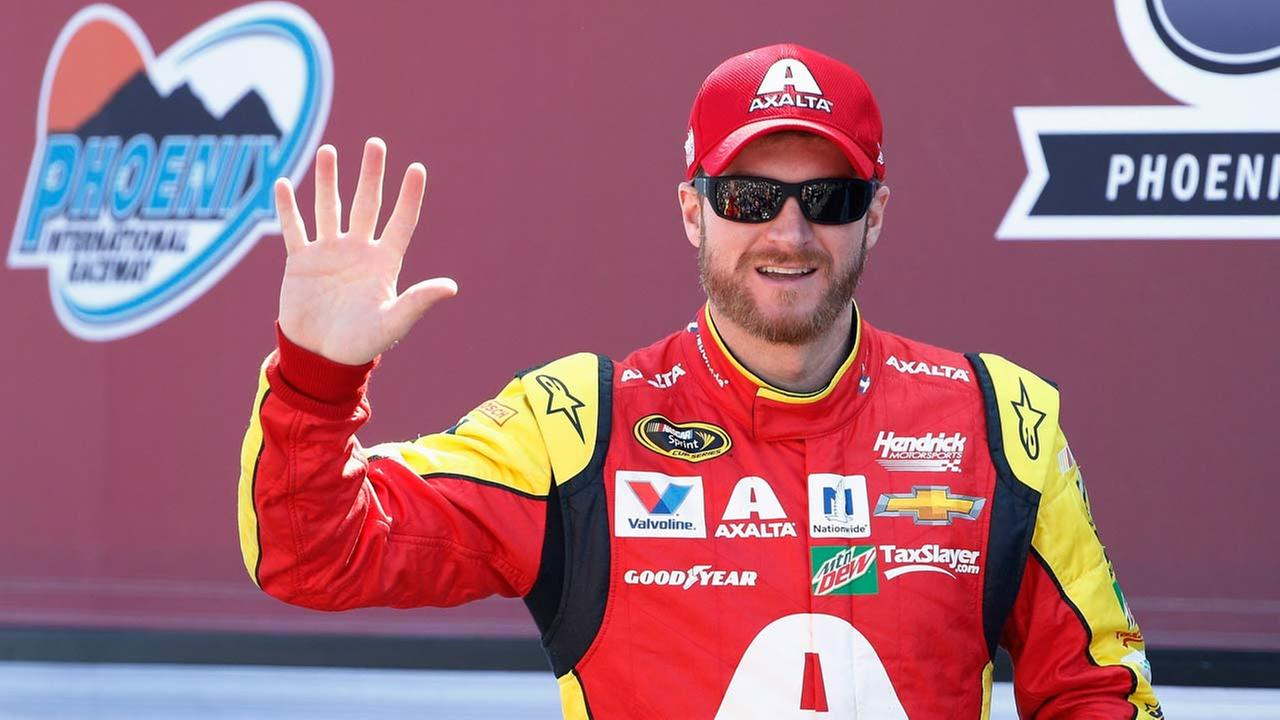 Dale Earnhardt Jr. waves to the crowd during driver introductions prior to a NASCAR Sprint Cup Series auto race at Phoenix International Raceway, Sunday, March 13, 2016.