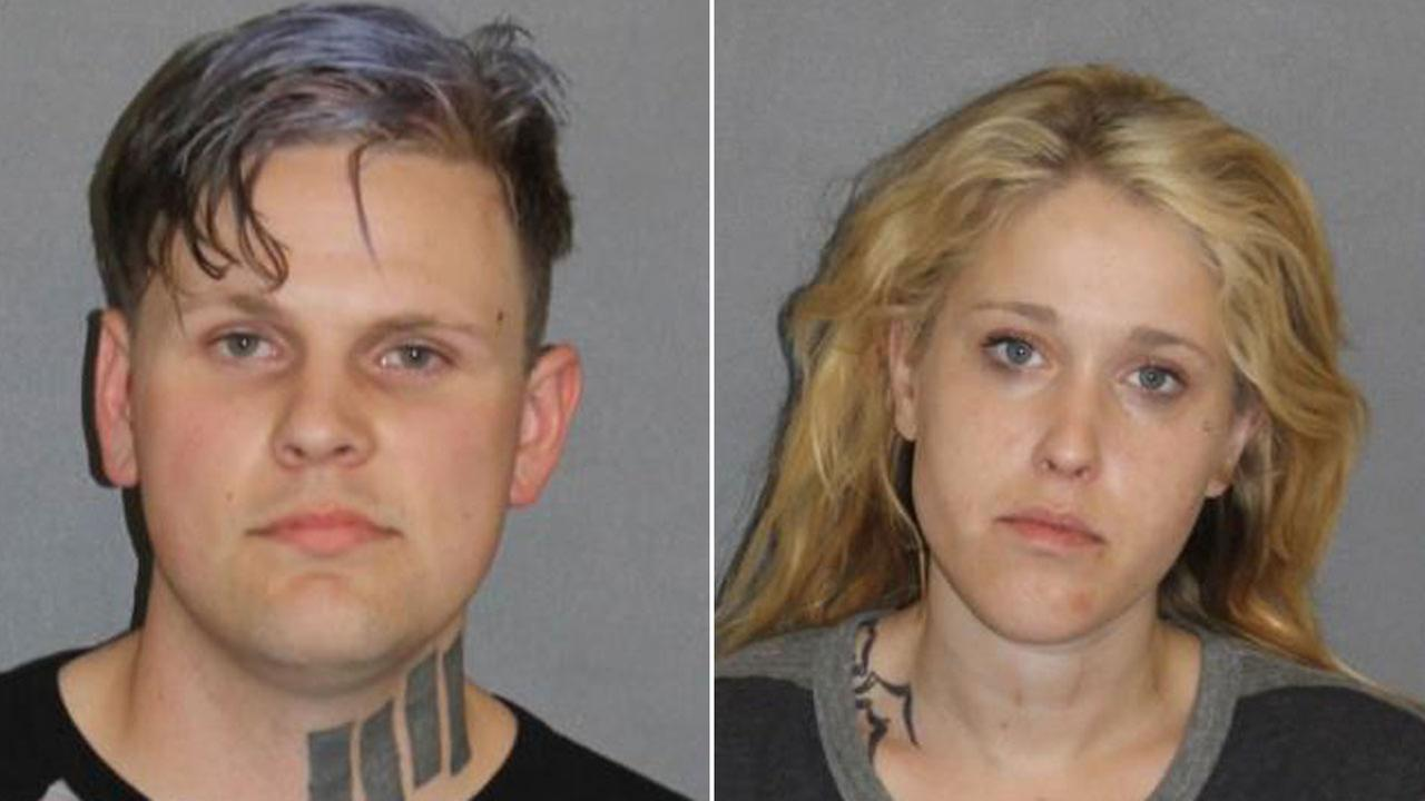 Christopher Shopshire, 26, and his wife Stacie Shopshire, 25, are shown in mugshots.