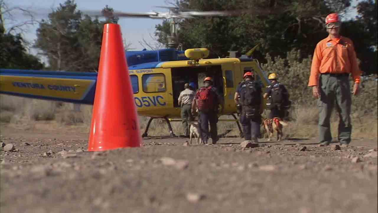Crews are seen searching for Arcadia firefighter, Mike Herdman, in the Los Padres National Forest above Fillmore.