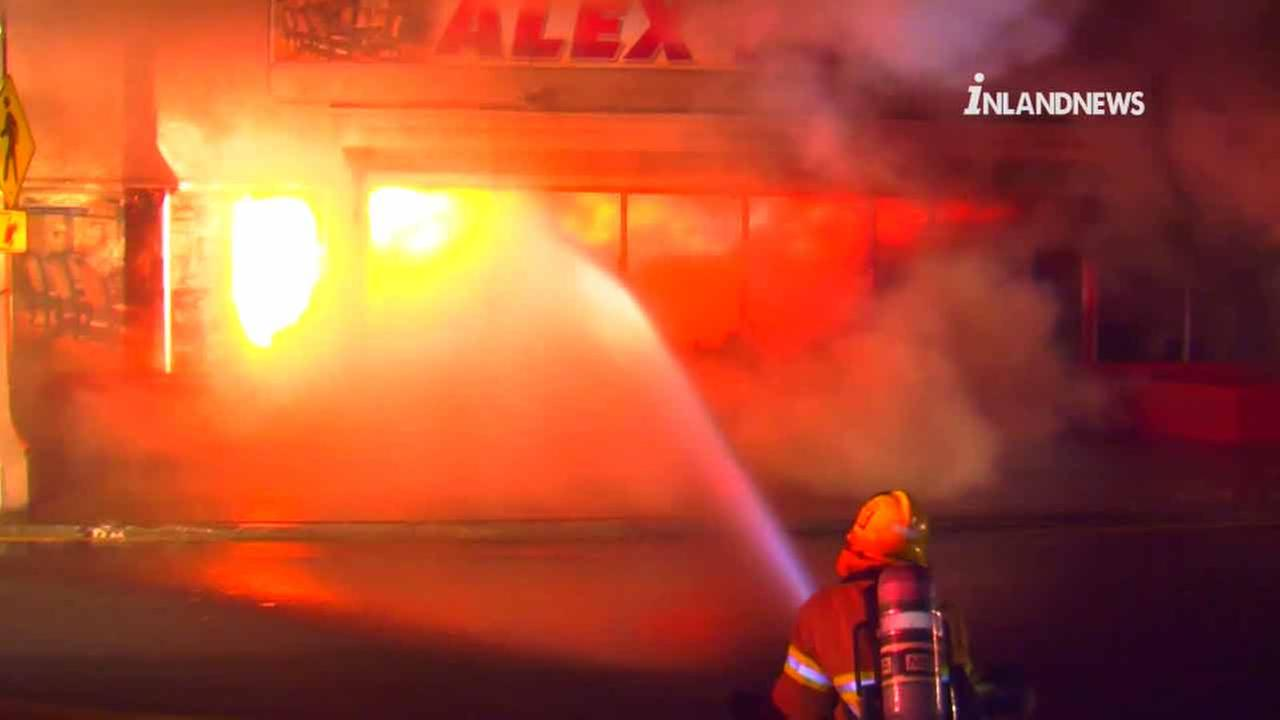 Ontario firefighters battle a large blaze that erupted inside a business in Ontario, Calif., on Sunday, April 3, 2016.