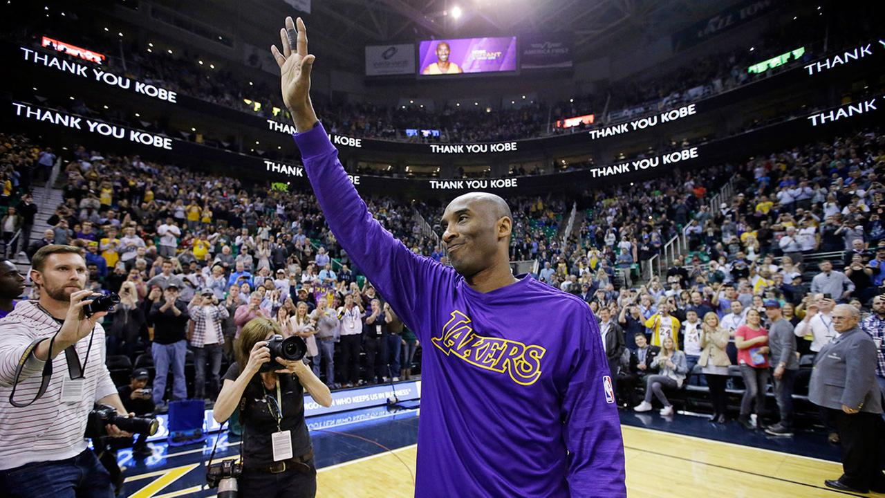 Los Angeles Lakers forward Kobe Bryant waves to the fans after his introduction before the start of the first quarter of an NBA basketball game against the Utah Jazz Monday, March 28, 2016, in Salt Lake City.