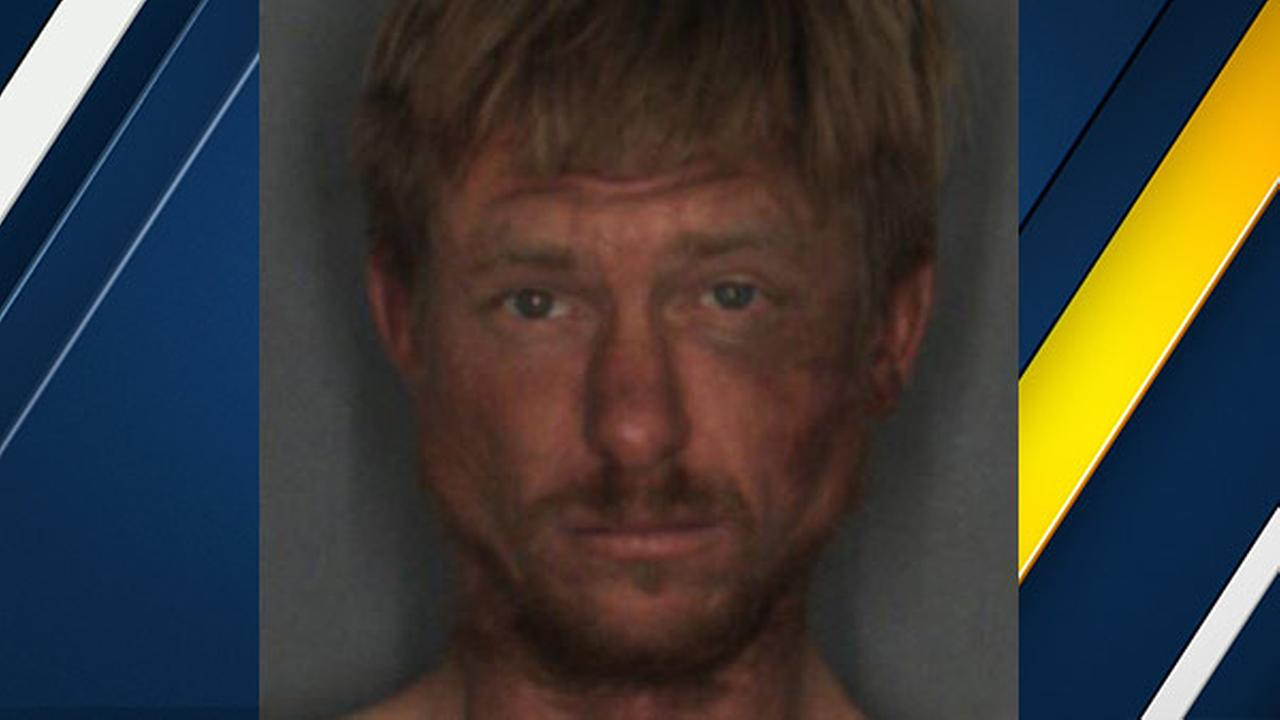 Caulin Matthew Ross, 32, is seen in a mugshot photo from Redlands police.
