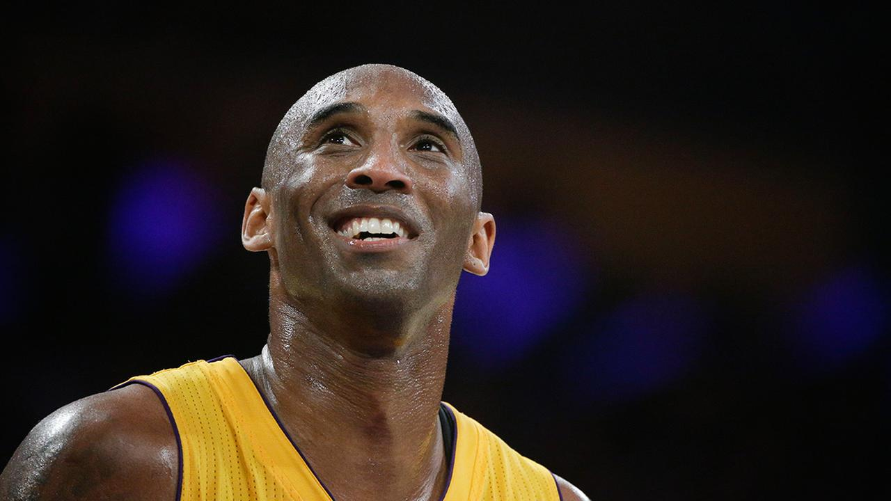 Los Angeles Lakers Kobe Bryant smiles during the first half of Bryants last NBA basketball game, against the Utah Jazz on Wednesday, April 13, 2016, in Los Angeles.