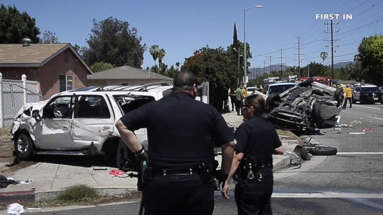 Los Angeles police respond to a fatal crash near Haskell Avenue and Parthenia Street in North Hills Sunday, April 17, 2016.