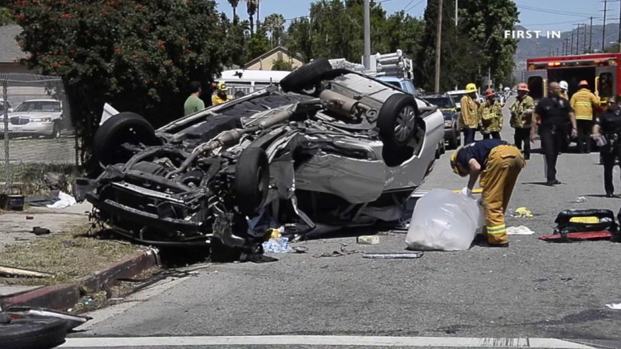A crushed Toyota Sienna is shown upside-down after a fatal crash in North Hills on Sunday, April 17, 2016.