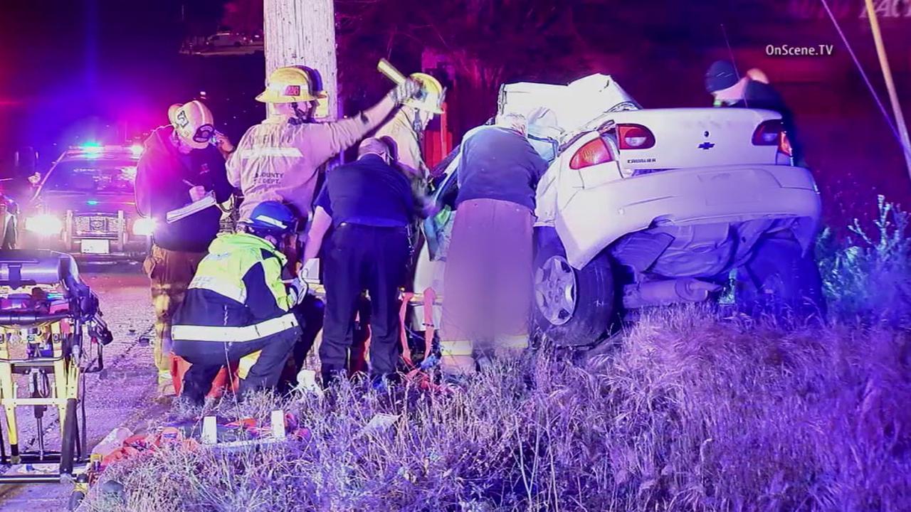 Los Angeles County sheriffs deputies investigate a fatal crash in the 23000 block of N. Sierra Highway in Santa Clarita on Tuesday, April 26, 2016.