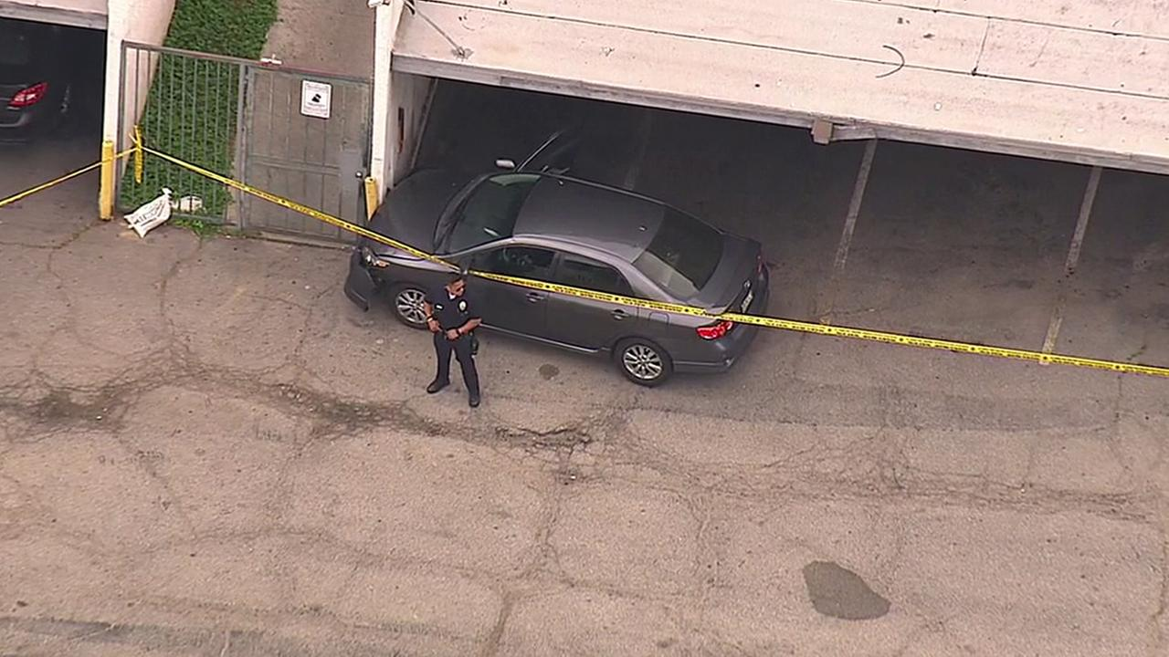 Los Angeles police investigate a fatal shooting inside the carport of a large apartment building in the 18600 block of Hatteras Street in Tarzana Thursday, May 5, 2016.