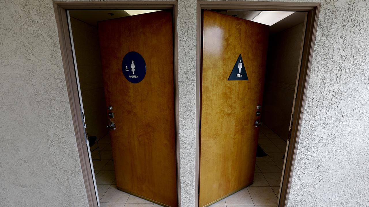 In this image taken with a fisheye lens, the doors to public restrooms are propped open in Anaheim, Calif.