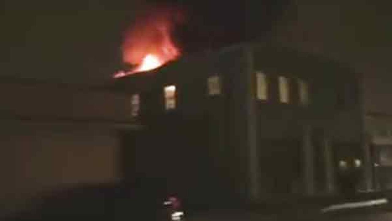 Flames shoot through the roof of a commercial building in South Gate on Friday, May 13, 2016.