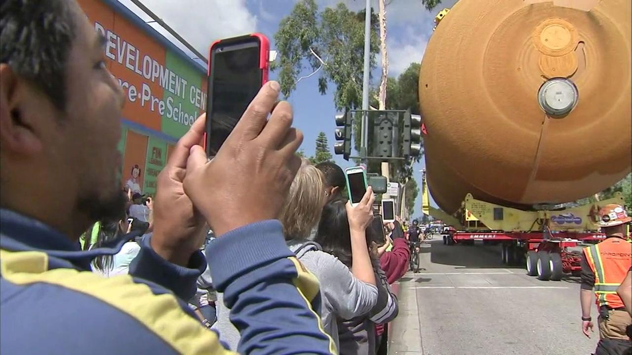 Spectators took photos and videos as ET-94 slowly  moved through the streets of Los Angeles to the California Science Center on Saturday, May 21, 2016.