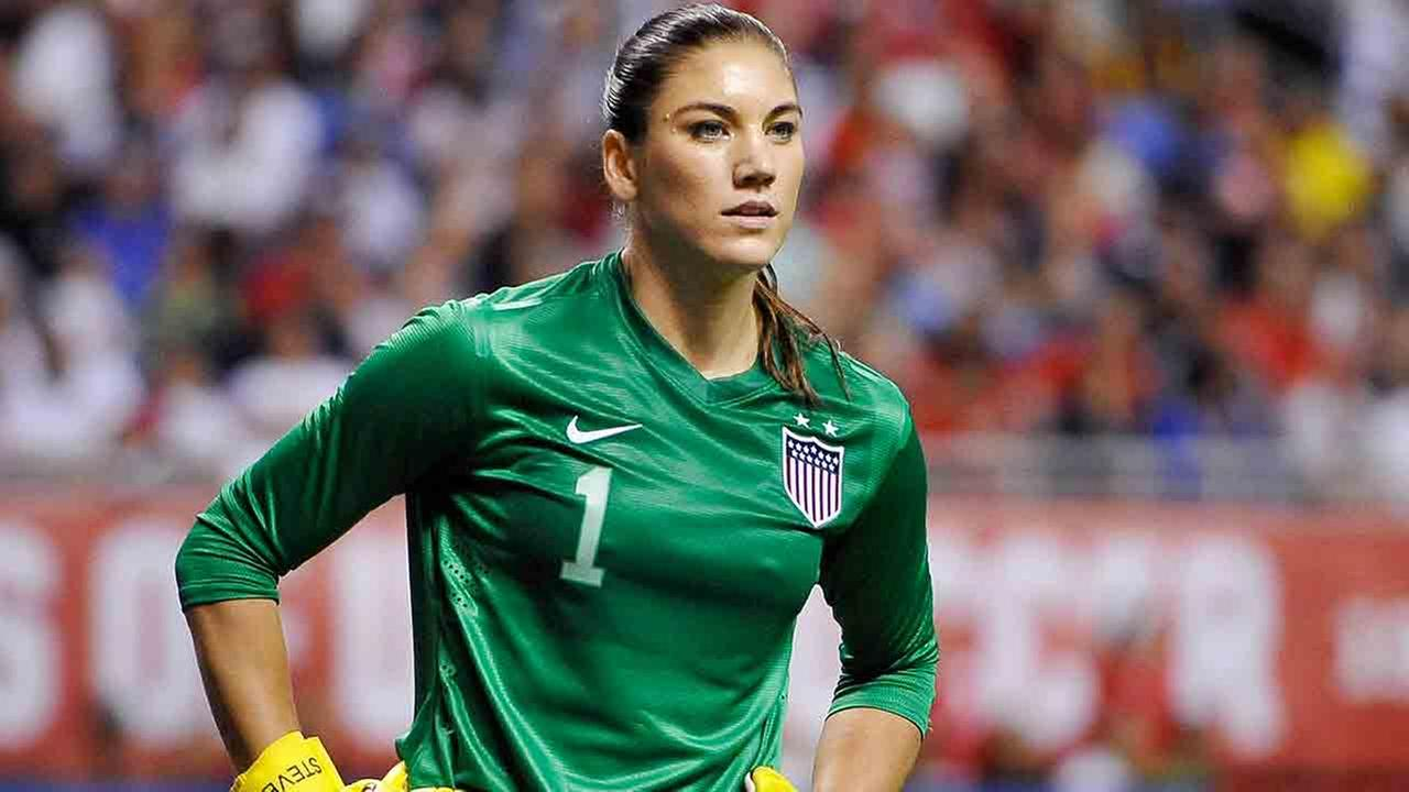 In this Oct. 20, 2013, file photo, United States goalkeeper Hope Solo pauses on the field during the second half of an international friendly womens soccer match.
