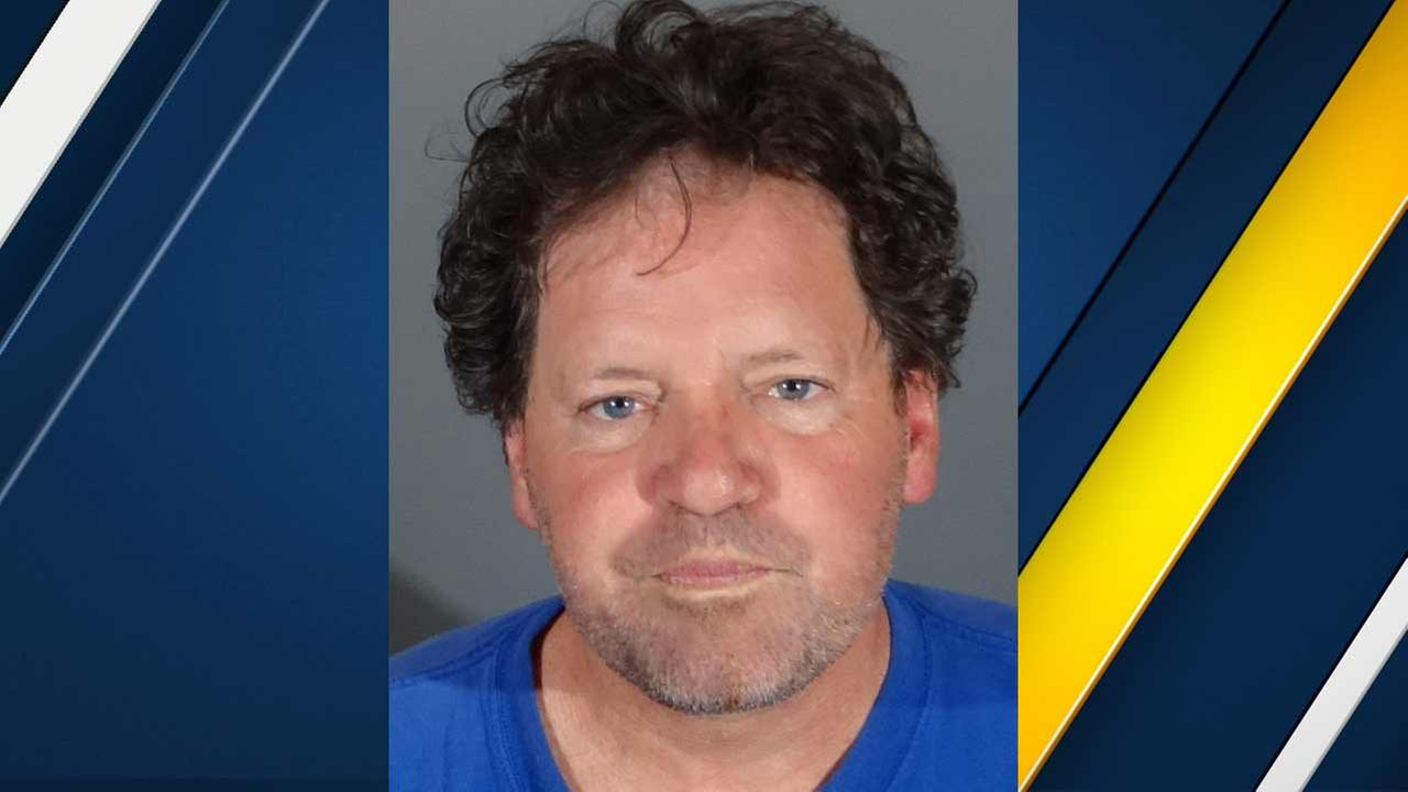 Roger Clinton, 59, is seen in a booking photo provided by the Redondo Beach Police Department.