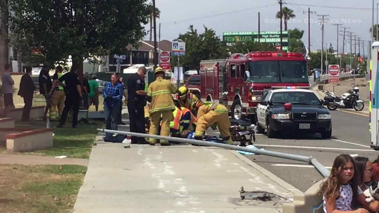 Emergency crews come to the aid of a man struck by a female driver in Costa Mesa on Friday, June 10, 2016.