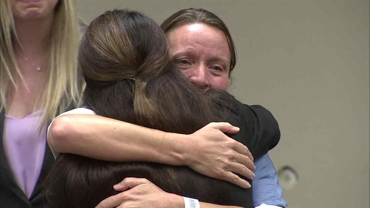 Kimberly Long hugs loved ones after a Riverside judge threw out her murder conviction on Friday, June 10, 2016.