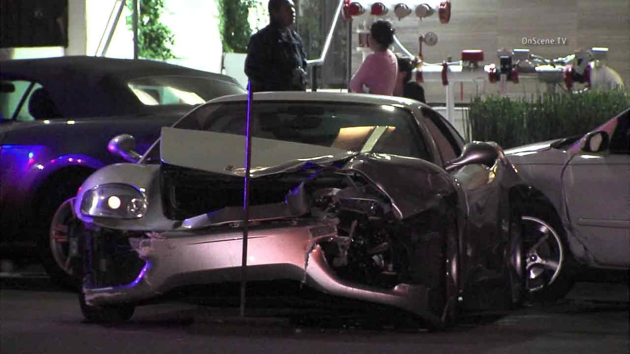 A silver Ferrari is seen mangled after slamming into three parked cars in Brentwood on Friday, July 1, 2016.