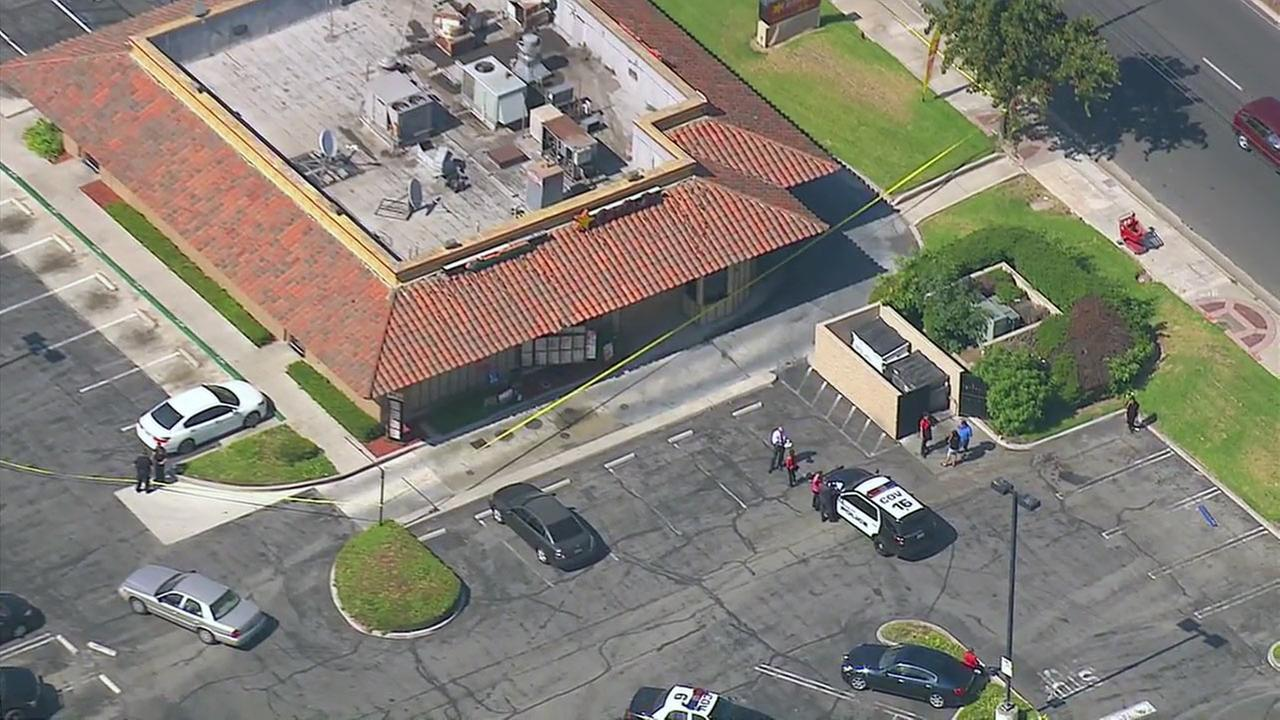 An off-duty officer with the Los Angeles Police Department shot and killed a robbery suspect on Wednesday, July 6, 2016, according to officials.