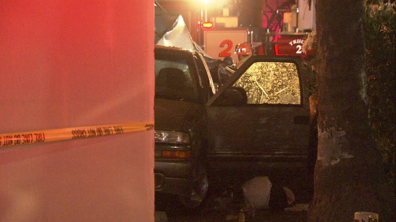 Authorities looked over the scene after a car crashed into a taco stand in Boyle Heights on June 26, 2016, which left one man dead.