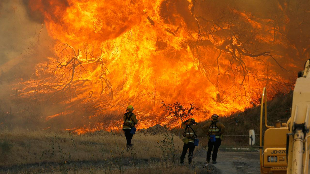 A hillside erupts in flame as a raging wildfire fire burns in Placerita Canyon in Santa Clarita, Calif., Monday, July 25, 2016.