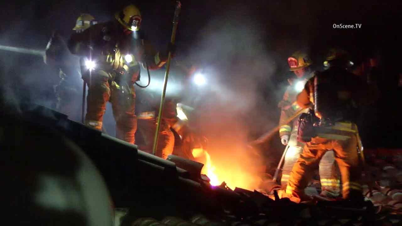 Firefighters at the scene of a fire in a remote canyon home in the Verdugo Mountains of the northeast San Fernando Valley on Saturday, July 31, 2016.