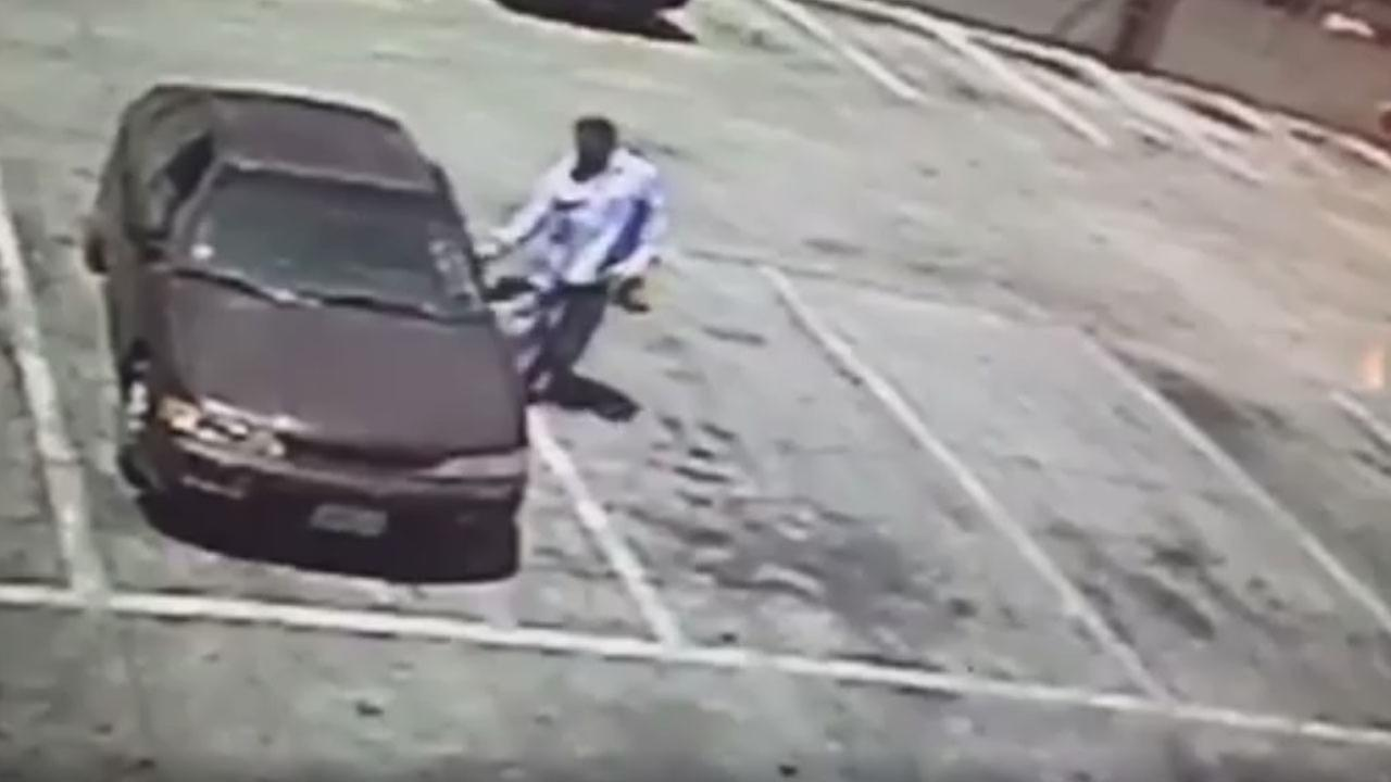 A person of interest is shown getting into a car that was involved in a fatal motorcycle crash near Santa Ana.