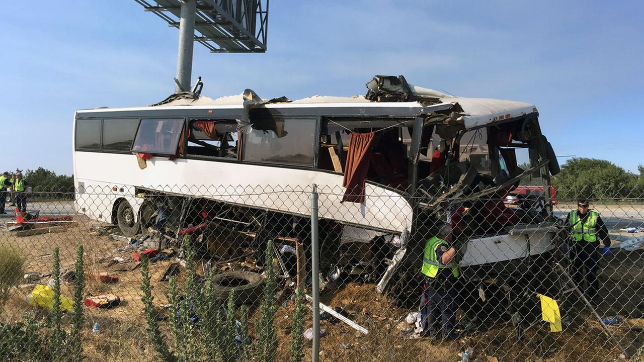 California Highway Patrol officers investigate the scene of a charter bus crash on northbound Highway 99 between Atwater and Livingston, Calif., Tuesday, Aug. 2, 2016.