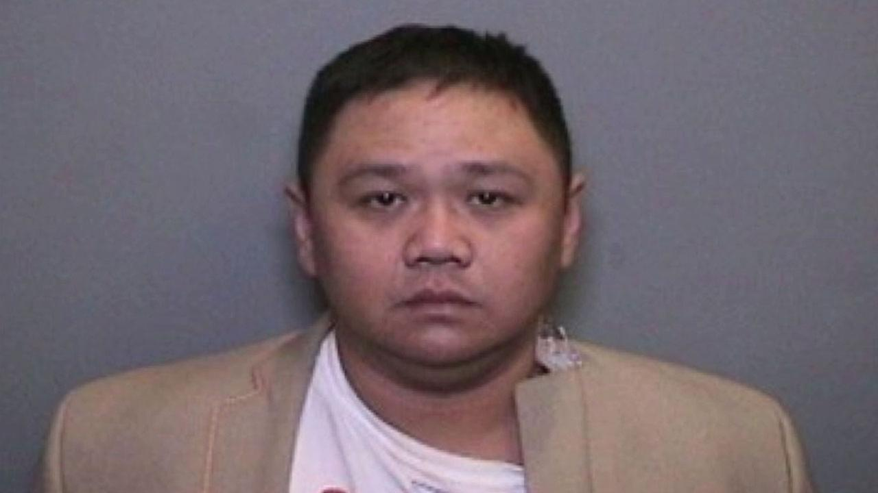 Minh Quang Hong, also known as Minh Beo, is shown in a mugshot.