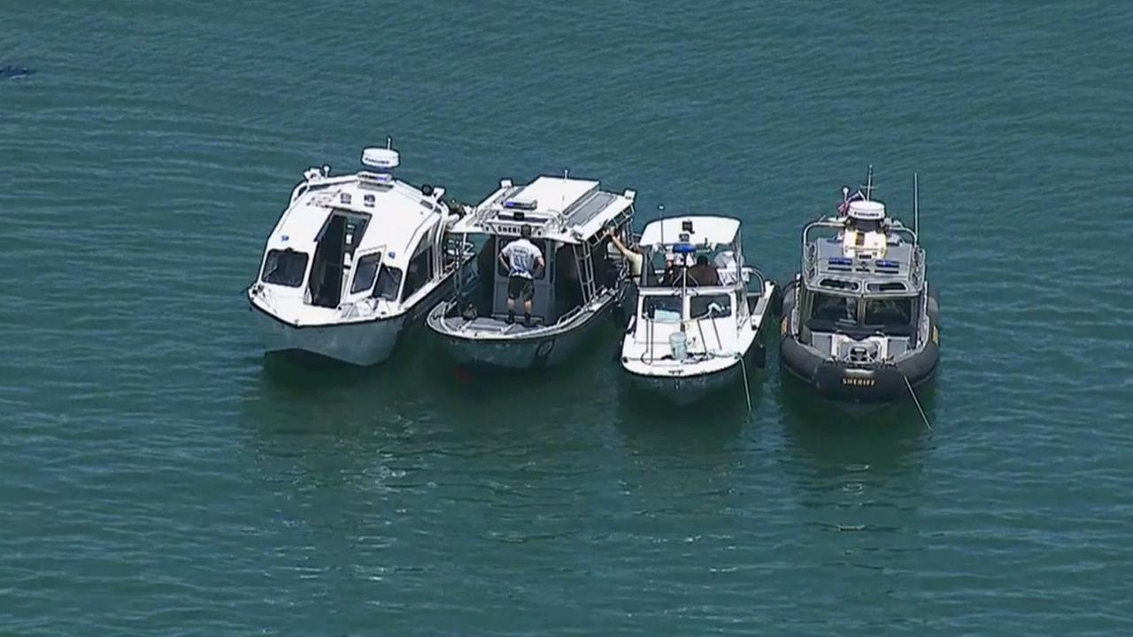 Authorities gather their boats to search for possible missing people after a boat overturns on Lake Pyramid on Sunday, June 29, 2014.
