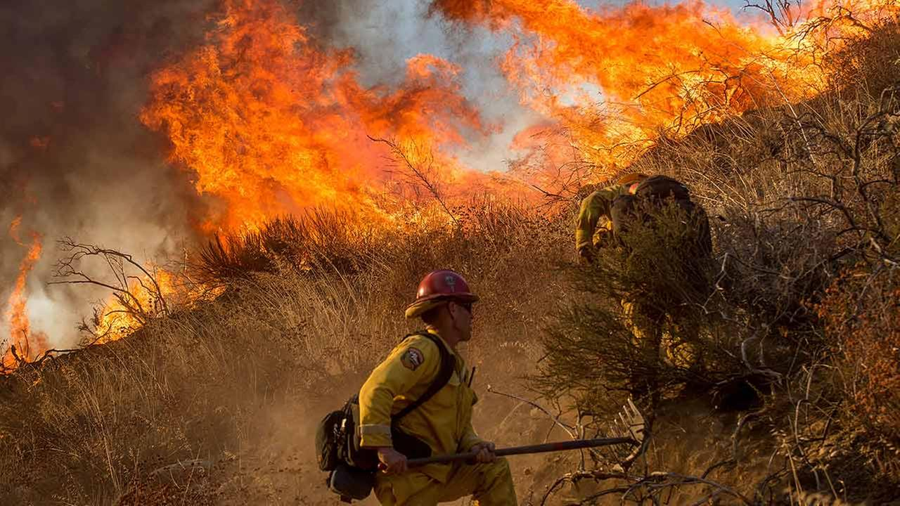 Firefighters battle a wildfire on Cajon Boulevard in Keenbrook, Calif., on Wednesday, Aug. 17, 2016.