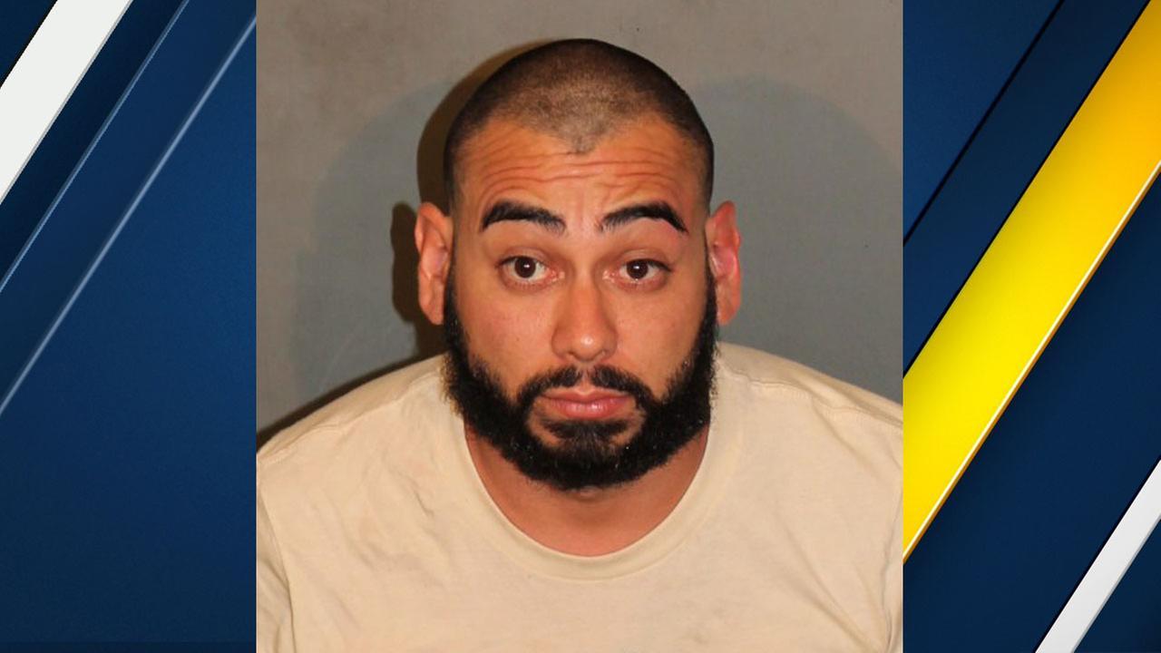 Nicholas Stephen Munoz, 27, is shown in a mugshot.