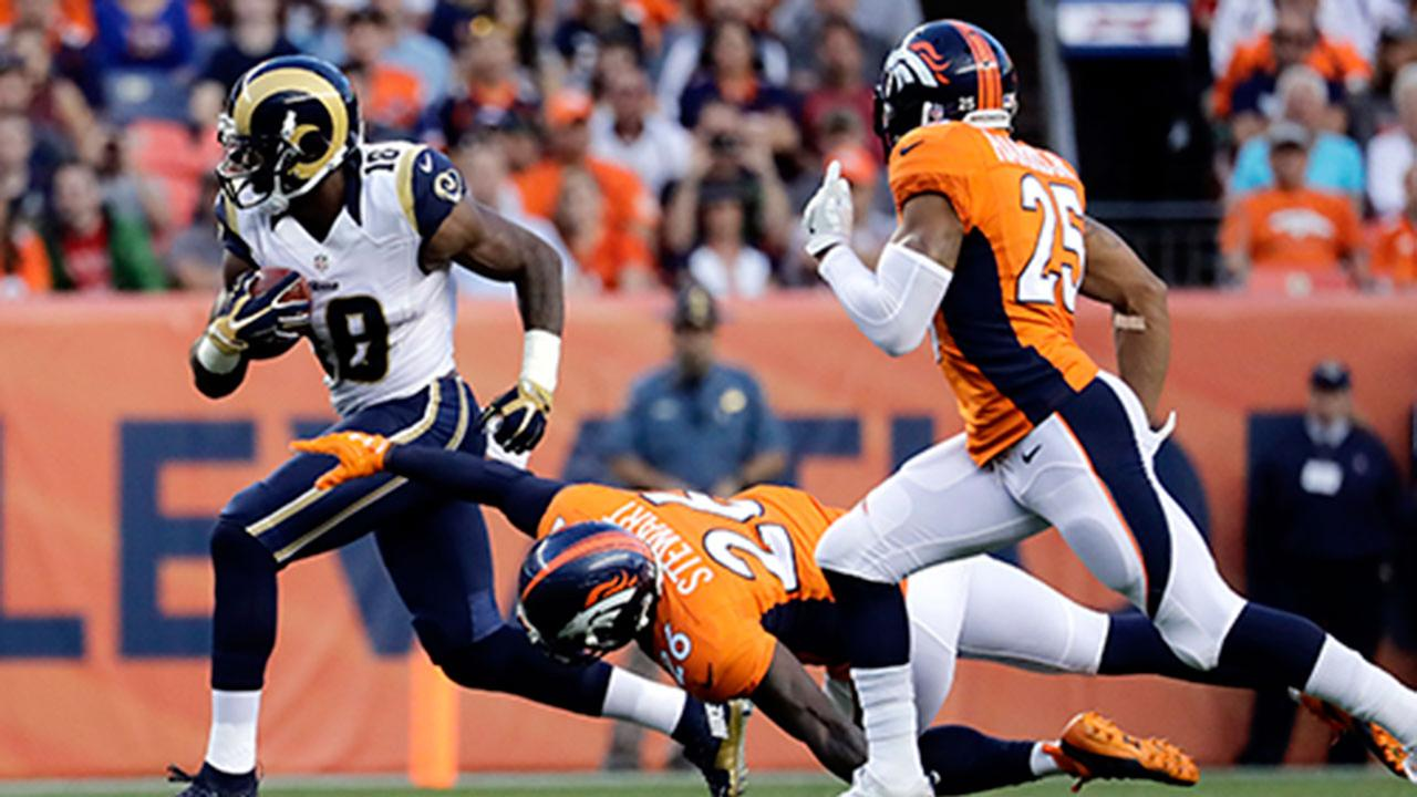LA Rams wide receiver Kenny Britt (18) eludes a tackle by Broncos free safety Darian Stewart (26) during the Rams 17-9 preseason loss in Denver on Saturday, Aug. 27, 2016.