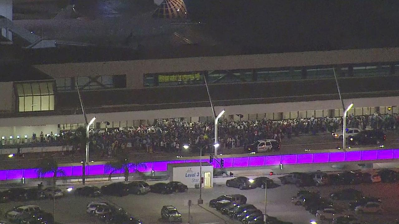 Hundreds of travelers waited outside terminals at the Los Angeles International Airport after a false report of an active shooter caused a panic on Sunday, Aug. 28, 2016.