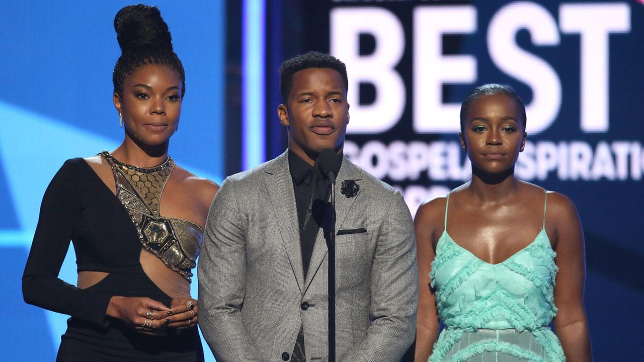 Gabrielle Union, from left, Nate Parker and Aja Naomi King present the award for Dr. Bobby Jones best gospel/inspirational award at the BET Awards at the Microsoft Theater.