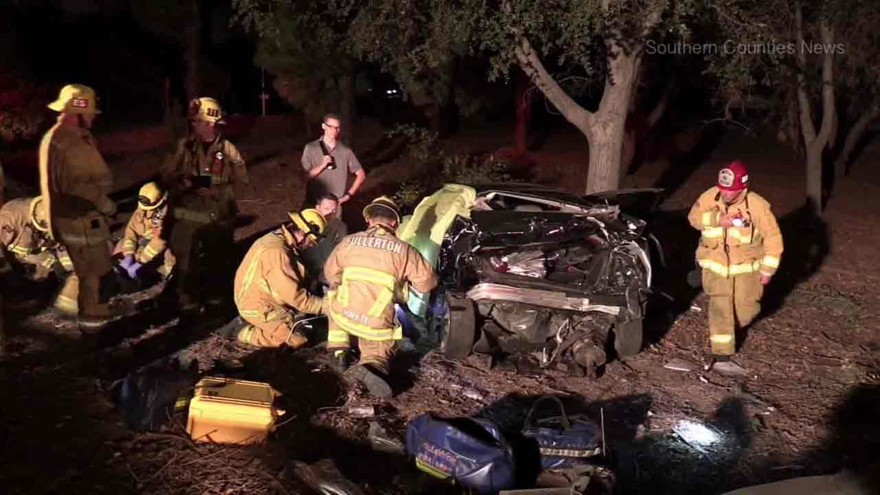 Firefighters at the scene of a crash that killed a 15-year-old boy in Fullerton on Sunday, Sept. 4, 2016.