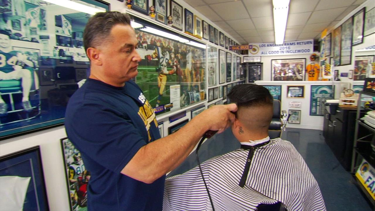 Sal Martinez owns Golden Ram Barber Shop in Westminster and may be a cut above other Los Angeles Rams super fans.