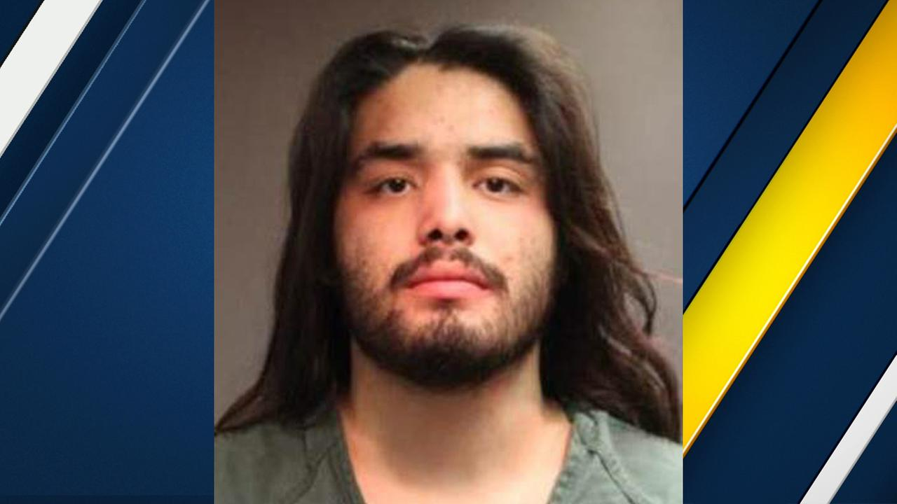 Matthew Jacob Granados, 21, is seen in a booking photo after turning himself in to Tustin police.