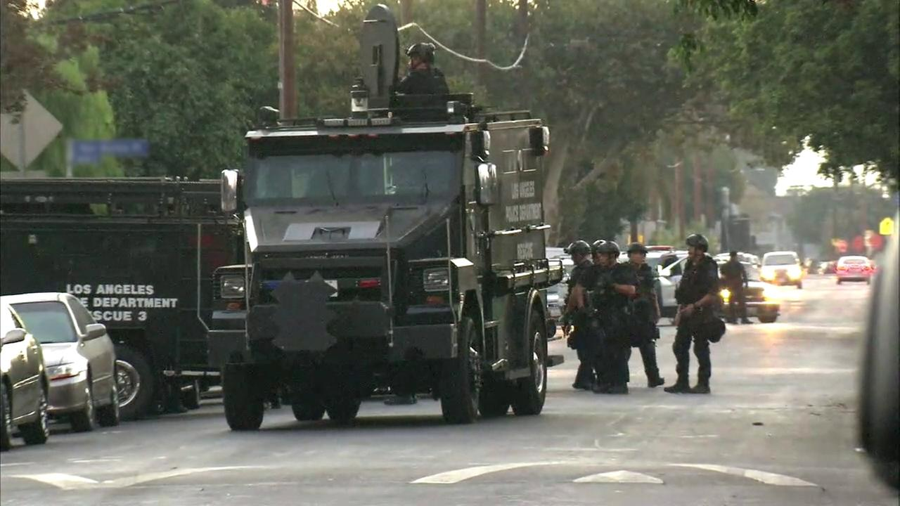 A Los Angeles Police Department SWAT team responded after several suspects barricaded themselves inside a home in South L.A. on Thursday, Sept. 8, 2016.