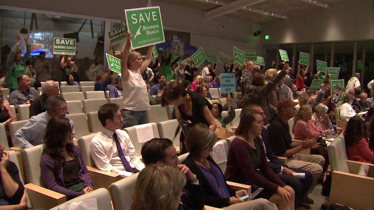 Activists cheer after the California Coastal Commission voted to reject a development project proposed for the Banning Ranch area of Newport Beach on Wednesday, Sept. 7, 2016.