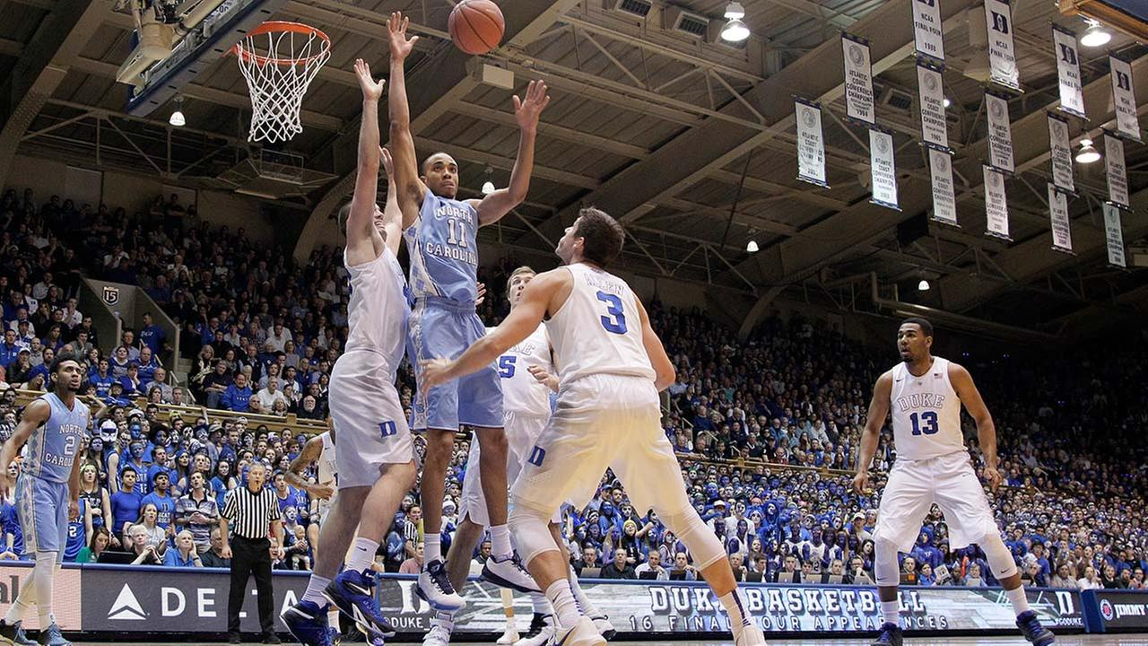 File photo shows North Carolina and Duke in the first half of an NCAA college basketball game in Durham, N.C., Saturday, March 5, 2016.
