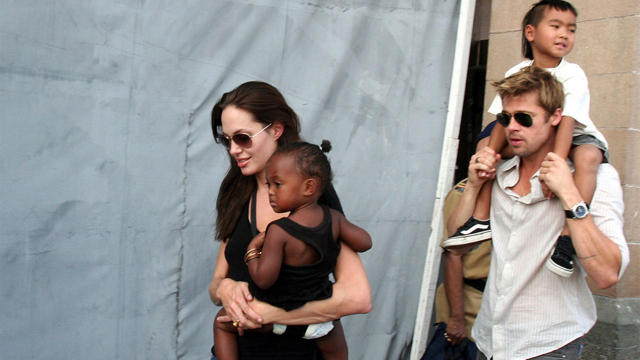 In this Nov. 12, 2006 file photo,  actress and UNHCR Ambassador Angelina Jolie, left, with her daughter Zahara, and Brad Pitt, right, with Jolies son Maddox, walk in India.