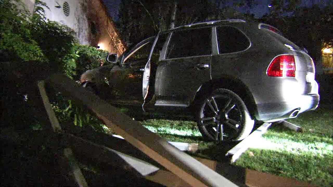 The aftermath of a car crash into a house in Bel Air on Wednesday, Sept. 28, 2016.