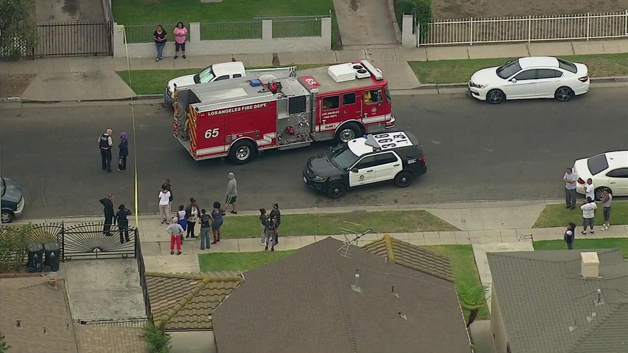 Police and firefighter-paramedics responded Wednesday, Oct. 12, 2016, to a double shooting in South Los Angeles.